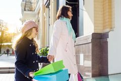 Mother And Child Daughter Enjoying Shopping Trip Together. Mother And Daughter Enjoying Shopping Trip Together Royalty Free Stock Photography