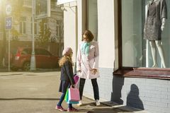 Mother And Daughter - Enjoying Shopping Trip Together. Mother And Daughter Enjoying Shopping Trip Together Stock Photography