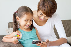 Mother and daughter enjoying their smartphone Royalty Free Stock Image