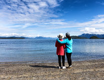 Mother and daughter enjoying their time on the lake together Royalty Free Stock Photo