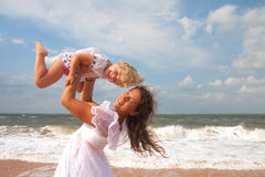 Mother and daughter enjoying time at beach Royalty Free Stock Images