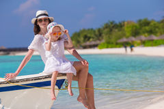 Mother and daughter enjoying time at tropical beach Royalty Free Stock Photography