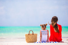 Mother and daughter enjoying time at tropical beach Royalty Free Stock Photo