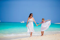 Mother and daughter enjoying time at tropical beach. Happy family on summer holidays at exotic island Stock Photo