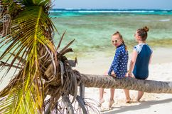 Mother and daughter at beach. Mother and daughter enjoying tropical beach vacation stock images