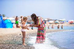 Mother and daughter enjoying vacation at the sea stock photo