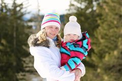 Mother and daughter enjoying winter at ski resort Stock Image