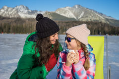 Mother and daughter enjoying winter vacations. On the mountains Stock Photography