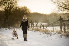 Mother and daughter enjoying the winter Royalty Free Stock Photo