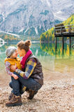 Mother and daughter Eskimo kisses on the shores of Lake Bries Royalty Free Stock Photos