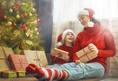 Mother and daughter exchanging gifts Stock Images