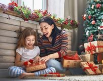 Mother and daughter exchanging gifts Royalty Free Stock Images