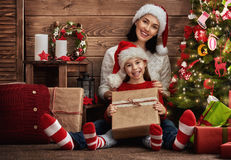 Mother and daughter exchanging gifts royalty free stock photography