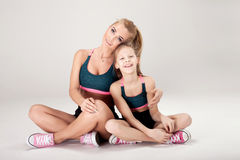 Mother and daughter exercise. Royalty Free Stock Photography