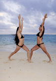 Mother and daughter exercising Stock Image