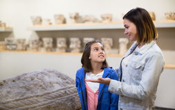 Mother and daughter exploring bas-reliefs in museum Royalty Free Stock Photos
