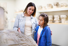 Mother and daughter exploring bas-reliefs in museum Stock Photography