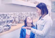 Mother and daughter exploring bas-reliefs in museum Stock Image