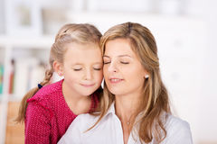 Mother And Daughter With Eyes Closed Royalty Free Stock Photography