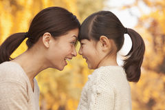 Mother and Daughter face to face Stock Photos