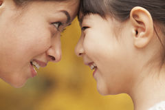 Mother and Daughter face to face Stock Photography