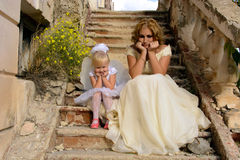Mother and daughter. Fairy and angel on the stairs next to the abandoned house Stock Image
