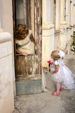 Mother and daughter. Fairy and angel on the stairs next to the abandoned house Royalty Free Stock Photos