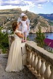 Mother and daughter. Fairy and angel on the stairs next to the abandoned house Royalty Free Stock Photography