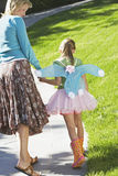 Mother With Daughter In Fairy Costume Walking On Path Royalty Free Stock Photos