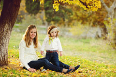 Mother and daughter in fall Stock Photos
