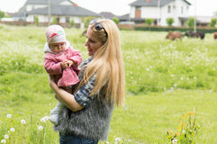 Mother with a daughter on a farm Stock Image