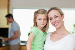 Mother and daughter with father in the background Stock Photos