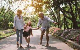 Happy family holding hand stock photos