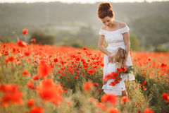 Mother and daughter in a field of blooming poppies Royalty Free Stock Photography