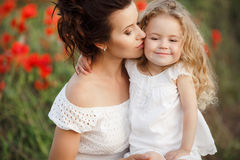 Mother and daughter in a field of blooming poppies Royalty Free Stock Photos
