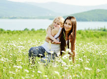 Mother and daughter in field Royalty Free Stock Photo