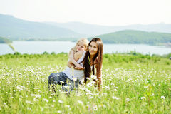 Mother and daughter in field Stock Photo
