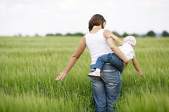 Mother and daughter in field Royalty Free Stock Photos