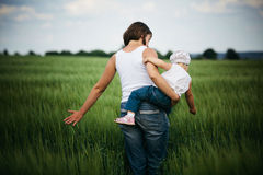 Mother and daughter in field Royalty Free Stock Images