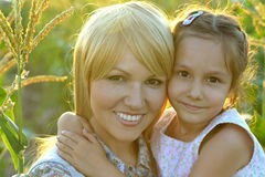 Mother and daughter at field Royalty Free Stock Photo