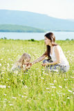 Mother and daughter in field Stock Photography