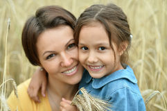 Mother and daughter at field Stock Image