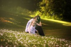 Mother and daughter in field of wildflowers Royalty Free Stock Photos