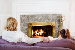 Mother & daughter by the fire Royalty Free Stock Photography