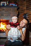 Mother and daughter in the fire, the comfort of home Stock Photography