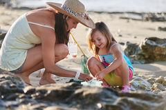 Mother daughter fishing beach Stock Photo