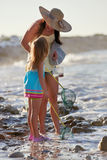 Mother daughter fishing beach Royalty Free Stock Photo