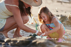 Mother daughter fishing beach Stock Photography
