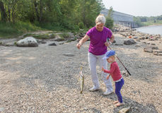 Mother and daughter fishing. Mother and daughter catching a fish Stock Photography