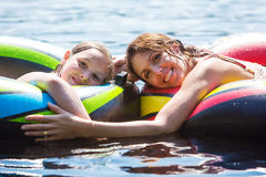 Mother and Daughter floating on a lake stock photography